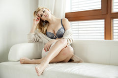 Beautiful and sexy woman in lingerie and sweater Stock Images