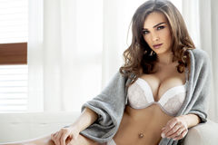 Beautiful and sexy woman in lingerie and sweater Stock Photo