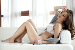 Beautiful and sexy woman in lingerie and sweater Stock Photos