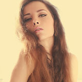 Beautiful sexy woman with long hair in sun light. Closeup art Royalty Free Stock Image