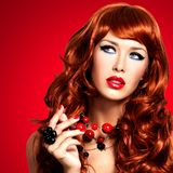 Beautiful woman with long red hairs and bright red lips stock photo