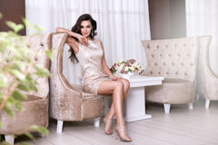 Beautiful sexy woman luxary dress jewelry make-up interior Stock Image