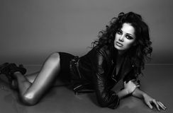 Beautiful sexy woman with luxurious curly hair in elegant jacket Stock Photo