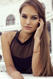 Beautiful woman with luxurious long hair in elegant black dress royalty free stock photos
