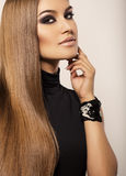 Beautiful sexy woman with luxurious straight hair Stock Images