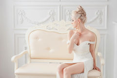 Beautiful sexy woman in luxury interior glamour fashion. gorgeous blonde girl in hotel. vogue style fashion woman in Royalty Free Stock Images