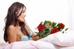 Beautiful sexy woman lying on bed Stock Photography