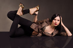 Beautiful sexy woman lying in leopard jacket Royalty Free Stock Photos