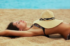 Beautiful sexy woman lying on sand Stock Images