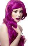Beautiful sexy woman with magnificent purple hair Stock Photography