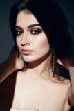 Beautiful sexy woman makeup dark shadows Stock Images