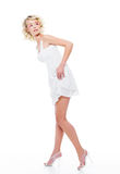 Beautiful sexy woman with modern. White dress posing in studio looking away Stock Photo