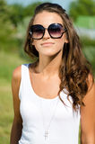 Beautiful sexy woman on the nature background in sunglasses Stock Photo