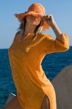 Beautiful and woman with orange dress Stock Photography