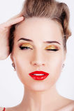 Beautiful sexy woman with party makeup winking Stock Image