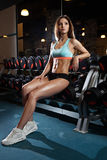 Beautiful sexy woman with perfect abdominal muscles at the gym Royalty Free Stock Image