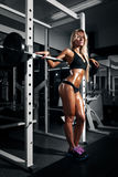 Beautiful sexy woman with perfect abdominal muscles at the gym Stock Image