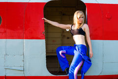 Beautiful sexy woman pilot in the door plane Royalty Free Stock Images