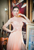 Beautiful woman in pink lace dress in vintage scenery Royalty Free Stock Photo