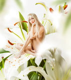 Beautiful sexy woman pixie in flowers Royalty Free Stock Photo