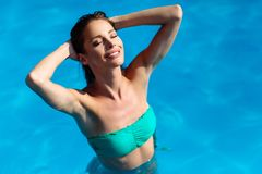 Beautiful sexy woman in pool. During summer royalty free stock images