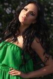 Beautiful sexy woman posing in summer park Stock Photos
