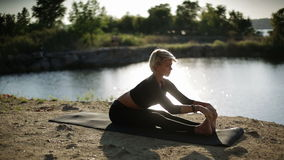 Beautiful sexy woman practicing yoga by doing different exercises stock footage