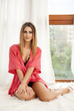 Beautiful and sexy woman in red bathrobe Royalty Free Stock Photos