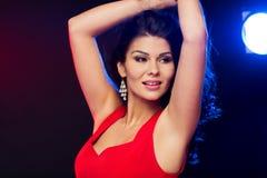 Beautiful sexy woman in red dancing at nightclub Stock Image
