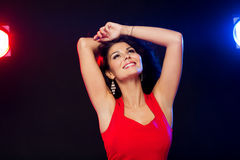 Beautiful sexy woman in red dancing at nightclub Royalty Free Stock Images