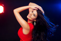 Beautiful sexy woman in red dancing at nightclub Stock Images