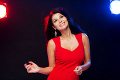 Beautiful sexy woman in red dancing at nightclub Royalty Free Stock Image