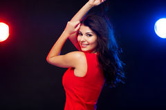 Beautiful sexy woman in red dancing at nightclub Stock Photography