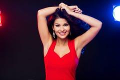 Beautiful sexy woman in red dancing at nightclub Stock Photos