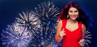 Beautiful sexy woman in red dancing over firework Royalty Free Stock Images