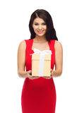 Beautiful sexy woman in red dress with gift box Stock Photography