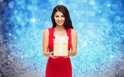 Beautiful woman in red dress with gift box Stock Image