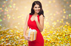 Beautiful sexy woman in red dress with gift box Stock Images