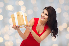 Beautiful woman in red dress with gift box Stock Photos