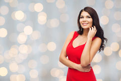 Beautiful sexy woman in red dress over lights Stock Photography
