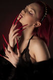 Beautiful sexy woman with red hair and long nails in fur coat Royalty Free Stock Photo