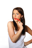 Beautiful sexy woman with red hot chilli pepper Stock Photos