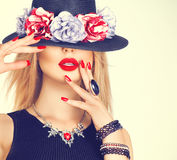 Beautiful woman with red lips in modern hat. Beautiful woman with red lips and manicure in modern hat royalty free stock images