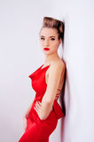 Beautiful woman in red satin dress and red lips Stock Photo