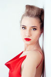 Beautiful sexy woman in red satin dress and red lips Stock Photos