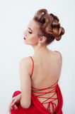 Beautiful sexy woman in red satin dress and red lips Royalty Free Stock Images