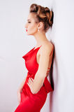 Beautiful sexy woman in red satin dress and red lips Royalty Free Stock Photography