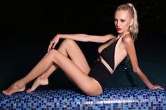 Beautiful sexy woman relaxing in night swimming pool Stock Photos
