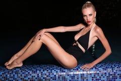 Beautiful woman relaxing in night swimming pool Stock Photo
