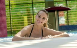 Beautiful Sexy Woman Relaxing In Swimming Pool. Stock Photos